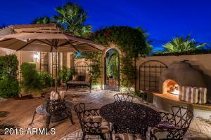 Lush Courtyard with Fireplace