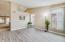 You view as you enter the house into the living/dining room area. Newly installed wood looking tile and 4 inch baseboards in all the main areas and bathrooms.