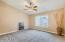 Spacious master bedroom which has new carpet , 4 inch baseboards and vaulted ceilings.