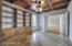 Beautiful office w/ built in library book shelves and coffered ceilings.