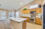 Open kitchen concept with a large island, perfect for entertaining ! Stainless steel appliances and under the counter lighting.