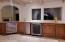 Kitchen area with wine coolers, garbage compactor