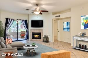 Modern, sunny living room.