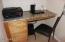 Oak cabinetry above & below as well as slab granite countertop