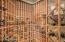 625 bottle wine cellar adjacent to the wet bar for easy entertaining