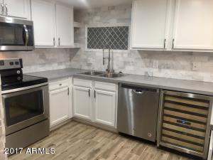 Kitchen with stainless steel appliances and wine fridge