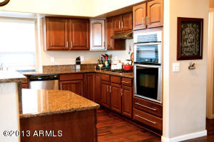 Cherry Cabinets, Granite Counter tops Stainless Steel Appliances and Hard Wood Floors