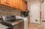 Laundry room with cabinets, Utility closet and sink