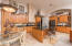 Kitchen with Granite Countertops and Staggered Cherrywood cabinets