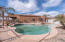 Pool area with lounging areas and pergolas