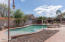 Pool area with lounging pergolas.