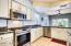 New Stainless gas range, microwave and dishwasher with subway tile backsplash.
