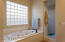 Large jetted tub and walk in shower completes the master bath