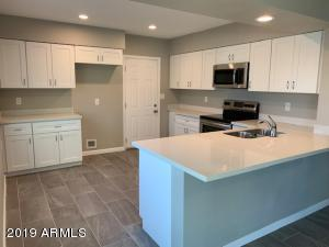 Beautiful New Shaker Kitchen Cabinets, new can lighting, new tile floor, new paint, new microwave, new stove, new dishwasher and new granite countertop