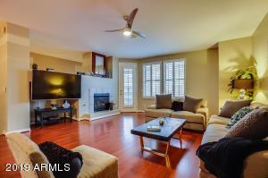 Living room w/fplc & door to balcony