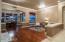 Beautiful wood floors and custom lighting in living room