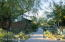 Private, beautifully landscaped, HOA maintained path to access front of home.