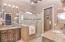 Dual Sinks, granite countertops, tile surround shower