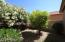 Four fruit trees and lush foliage complement this spacious backyard!