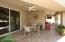 Enjoy this beautiful setting morning, noon and night! Cooling ceiling fans around extended patio with western tiles