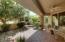 Extended covered patio with ceiling fans will keep you cool in the summer! Private and lush...