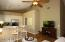 Modern and stately with recessed lighting and ceiling fans!