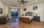2nd Bedroom suite with doorway to backyard patio