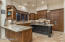 Gourmet Kitchen with Wolf Range and microwave and SubZero Refrigerator