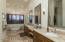 Master bath with dual sinks, separate tower and tub and TWO walk in Closets