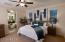Large master suite with outdoor access and plenty of views.