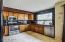 Fill granite tile backsplash and wall above sink