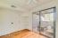 Gleaming wood floors and sliding glass door to balcony accent the 3rd bedroom, which is also perfect for an office or den.