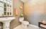 Designer paint and special touches accent powder room on first floor.