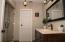 The master bathroom is spacious and allows plenty of room to get ready in the morning.