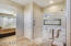 Linen closet and large custom walk in shower