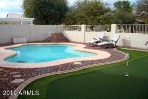 Relax in your Solar Heated Pool, and take a few strokes on your personal putting green.