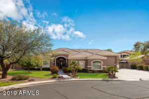 Custom home on cul-de-sac corner on a HUGE lot! Gated community with friendly neighbors!