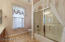 Tub shower enclosure in guest bathroom.