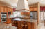 This kitchen is amazing! Custom cabinets, cook top hood, granite counters &