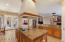 Large kitchen island with tons of prep or serving space plus lots of cabinets!