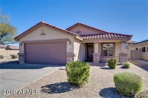 Four bedroom home in desirable Gilbert location! Community playground is across the street!