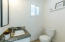 Half bathroom features high end finishes and natural light.