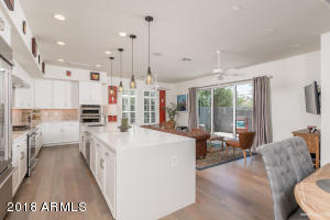 Light & Bright Greatroom floorplan with beautiful wood floors thoughout!