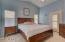 Backyard exit, vaulted ceiling, plantation shutters, window coverings, ceiling fans & designer colors