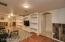Great Room with Built-Ins and looking into walk way to Master Suite.