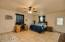 Huge Master Suite with tile flooring, ceiling fan and door to back yard.