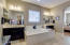 Master Bath with His and Hers sink and huge soaking tub.
