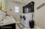 Large laundry with entrance from master closet or hall. Sink, counter and upper cabinets.
