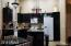 Nicely updated kitchen with granite countertops and refinished cabinets.