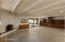 Sunken great room with polished concrete floors, gas fireplace + custom vintage built-ins
